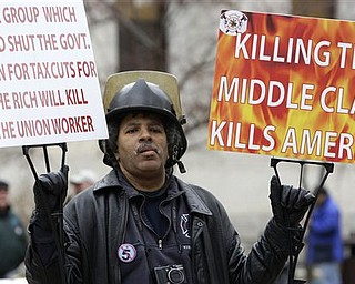 Walter Hudson, of Toledo, protests against Senate Bill 5 at the Ohio statehouse Tuesday, March 29, 2011, in Columbus, Ohio. The bill would strip public employees of collective bargaining rights.