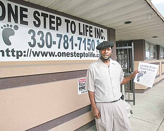 Glen Williams, executive director of One Step to Life, shows off a flier about one of the organization's support programs. One Step had a ribbon-cutting ceremony Wednesday to show off  its new offices on Midlothian Boulevard in Youngstown. One Step seeks to work with inner-city youths to stem crime and family violence