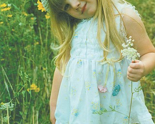 Lana Van Auker of Canfield sent in this photo of Leanna Hartsough at age 4. Leanna, who loves fields and flowers, is now a senior at Canfield High School.