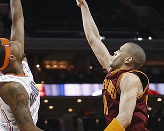Cleveland Cavaliers' Anthony Parker, right, takes the final shot as time expires as Charlotte Bobcats' Dominic McGuire, left, defends in the Bobcats' 98-97 win in an NBA basketball game in Charlotte, N.C., Wednesday, March 30, 2011.