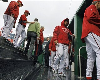 Washington Nationals hed to the clubhouse as practice is halted with a mix of rain and sleet at Nationals Park on Wednesday, March 30, 2011, in Washington. The Nationals' home-opener is scheduled for Thursday against the Atlanta Braves.