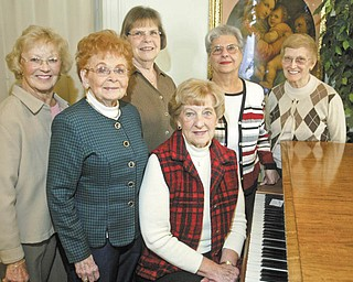 William D. Lewis | The Vindicator: Children will have an opportunity to travel the world through music during a concert Thursday arranged by, from left, Mary Place Thomas, Virginia Cooke, Carol Fithian, Ruth Stevenson, Mary Ann Fees and Mary Burkey, members of the Women's Committee for Children's Concerts.