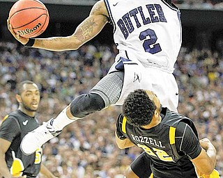 Butler's Shawn Vanzant (2) drives to the basket over Virginia Commonwealth's Brandon Rozzell during the first half of a men's NCAA Final Four semifinal college basketball game Saturday, March 2, 2011, in Houston.