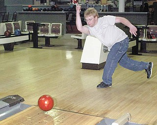 Chris Hood, a long-time employee at Kay Lanes in Girard, aims for the pins at the bowling alley which is closing. Hood started bowling there as a 7-year-old boy.