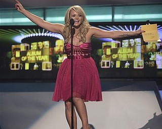 Miranda Lambert presents the award for album of the year at the 46th Annual Academy of Country Music Awards in Las Vegas on Sunday, April 3, 2011.