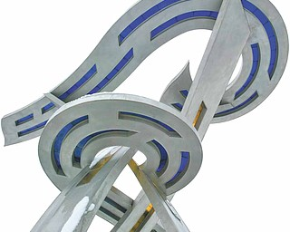"""""""Primary Compass,"""" a sculpture designed by Don Gummer and built by the Brilex Corp. in  Youngstown, serves as a landmark for the museum. It was built of stain-less steel and stained glass."""