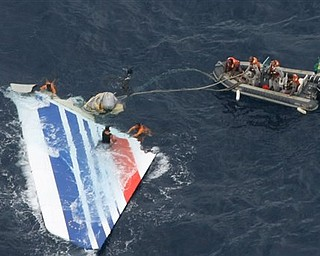 """In this Monday, June 8, 2009 file photo released by Brazil's Air Force, Brazil's Navy sailors recover debris from the missing Air France Flight 447 in the Atlantic Ocean. Undersea robots have located a """"large part"""" of an Air France jet that plunged into the Atlantic Ocean in 2009, but haven't yet found its black box flight recorders, French officials said Monday April 4, 2011.  Victims' families cautiously welcomed the surprise announcement that search teams have located pieces of the plane, after nearly two years of fruitless efforts to determine what caused it to crash. Investigators have said without the recorders, the cause may never be determined."""