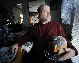 In this March 8, 2011 photo, Gary Quarles holds a helmet made in memory of his son Gary Wayne Quarles at his home in Naoma, W.Va. Gary Wayne Quarles and 28 other men died deep inside Massey Energy's Upper Big Branch mine on April 5, 2010 near Montcoal. It was the deadliest U.S. coal mining accident since 1970, and remains the target of civil and criminal investigations.
