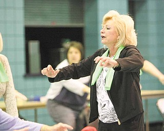 "Eve Bevilacqua, Mahoning Valley fitness instructor and personal trainer, leads a ""Well of Body"" program at the Ursuline Center in Canfield. She advised participants Tuesday to ""keep moving"" and maintain a positive attitude."