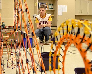Jackson Milton High School students have had to apply physics properties to improve their roller coaster made out of K'NEX for a nationwide competition. Senior Bethany Sitler said the process has involved trial and error.