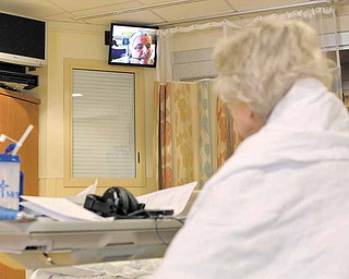 Intensive Care Nurse Lisa Manion (on screen) talks with an elderly patient in the intensive care unit of St. John's Mercy Medical Center, March 23, 2011, in Creve Coeur, Missouri.