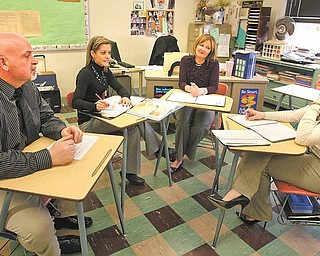 Boardman Glenwood teachers, from left, Bill Coler, Lisa Kutchel, Kathi Rothman and Jenn Dravecky, make up Gray 5, one of the team-teaching groups instituted this year. The teachers meet regularly to discuss lesson plans, student performance and behavioral issues.