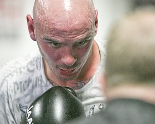 ROBERT K. YOSAY | THE VINDICATOR..Kelly Pavlik is back in the ring sparing and conditioning for his upcoming bout in May -- He sparred With ROMARO (ok) Johnson.-30-