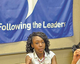 Taft Elementary School fifth-grader Jayda Day, 11, a member of her school's Destination Imagination team, talks about the competition that involves teamwork, creativity, problem solving, research and other skills.