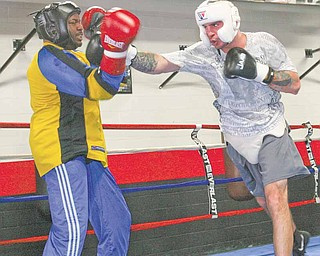Kelly Pavlik spars with Romaro Johnson during a conditioning session Thursday at the Southside Boxing Club. Pavlik is training for his upcoming bout with Alfonso Lopez on May 7 in Las Vegas. It will be the first time Pavlik will be back in the ring since losing his middleweight title to Sergio Martinez almost a year ago.