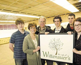 The Wittenauer family, from left, Ryan, 17, Terry, Doug, Mike, 21, Dave, 25, and Jessica, 22, will open a café in a former Poland pharmacy this fall.