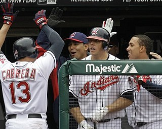 Cleveland Indians' Asdrubal Cabrera (13) is congratulated in the dugout in the eighth inning in a baseball game against the Boston Red Sox, Thursday, April 7, 2011, in Cleveland. Cabrera's suicide-squeeze bunt put the Indians ahead in their fourth straight victory, scoring Adam Everett. The Indians swept the series and won 1-0. (AP Photo/Tony Dejak)
