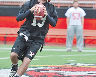 Youngstown State backup quarterback Marc Kanetsky gets ready to throw the ball during football practice Friday at YSU's Stambaugh Stadium.