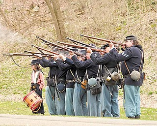 Members of the Western Pennsylvania Civil War Reenactors Society fire their rifl es during a spring drill Saturday afternoon at the Raisch Log Cabin in Sharpsville Community Park in Sharpsville, Pa.
