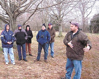 In Antietam's West Woods, from left,  Rock Basciano of Warren, Merle Linsenbigler of Vienna, Ruth Ann  Linsenbigler of Vienna, Mike Cummings of Hermitage, Pa., and Mike Miller of Vienna listen to tour guide  John Hoptak.