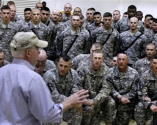 Defense Secretary Robert Gates speaks with from soldiers from the 4th Advise and Assist Brigade, 1st Calvalry Division out of Fort Hood, Texas, while visiting Camp Marez  in Mosul, Iraq, Friday, April 8, 2011.