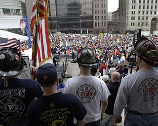 Firefighters stand on the Ohio Statehouse steps as protestors against Ohio's new state law that curtails the collective bargaining rights of more than 350,000 public workers gather for a rally launching the We Are Ohio campaign Saturday, April 9, 2011, in Columbus, Ohio. The We Are Ohio campaign, which bills itself as a grass-roots, bipartisan group, is signing up people to circulate petitions in pursuit of a referendum on the measure.