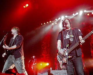 Guitarist John Rzeznik, left, and bassist Robby Takac of the Goo Goo Dolls perform at The Covelli Centre Tuesday, 4-12-11.