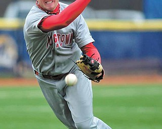 Youngstown State pitcher Padraic Williams makes the throw to first during Tuesday's game at Kent State.