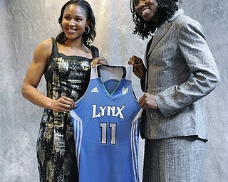 Connecticut's Maya Moore, left, and Xavier's Amber Harris, right, hold up a Minnesota Lynx jersey after being picked by the team in the WNBA basketball draft in Bristol, Conn., Monday, April 11, 2011.