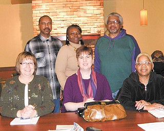 Completing arrangements for Tuesday's candidates forum are, from left, seated, representatives of the League of Women Voters of Trumbull County, Terri Crabbs, president; Janice Hardman, first vice president; and Mary Hoke, director; and standing, from left, representatives of the A. Philip Randolph Institute, Johnny Hugley, vice president; Kim Jones; and Charles R. Salter.