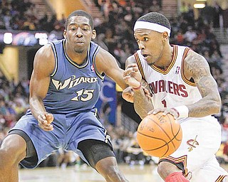 Cleveland Cavaliers' Daniel Gibson, right, drives on Washington Wizards' Jordan Crawford (15) in the first quarter of an NBA basketball game Wednesday, April 13, 2011, in Cleveland. (AP Photo/Mark Duncan)
