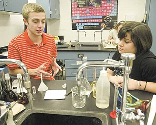 Students Vince DeChellis and Becca Mowad work together in their 11th grade chemistry class at Poland Seminary High School. The two are earning credit toward their college degrees in a program called College in High School.