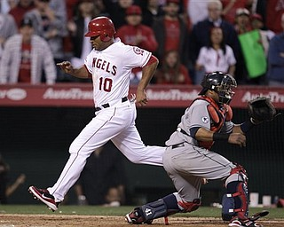 Los Angeles Angels' Vernon Wells (10) scores on a sacrifice by teammate Jeff Mathis to win a baseball game against the Cleveland Indians in the 12th inning in Anaheim, Calif., Wednesday, April 13, 2011. The Angels won 4-3. (AP Photo/Jae C. Hong)