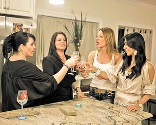 "In this publicity image released by VH-1, from left, Renee Graziano, Karen Gravano, Drita D'avanzo and Carla Facciolo, from the new reality series, ""Mob Wives,"" are shown in New York. The series premieres Sunday, April 17, 2011 on VH-1. (AP Photo/VH-1)"