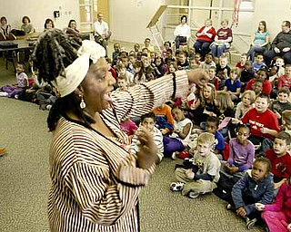 Storyteller Jocelyn Dabney of Youngstown is enthusiastic about the African-American oral tradition. She presented a program Friday at Liberty High School for pre-kindergarten through fourth-graders from E.J. Blott Elementary School.