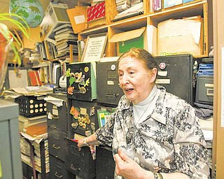 Ann Harris has an office and two storage rooms with stacks of files and drawers full of information about abandoned mines in Ohio and Pennsylvania. She's working weekly with a university archivist who will make sure the information is properly catalogued and kept in the future.