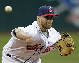 Cleveland Indians' Justin Masterson pitches against the Baltimore Orioles in the first inning of a baseball game Friday, April 15, 2011, in Cleveland. (AP Photo/Mark Duncan)