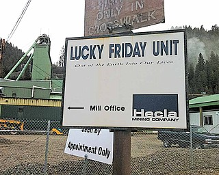 A sign for the Lucky Friday Mine is posted outside the mine in Mullan, Idaho, Saturday, April 16, 2011. An official with the Hecla Mining Company says a rescue operation is under way Saturday at the mine in northern Idaho. One miner reportedly is missing.