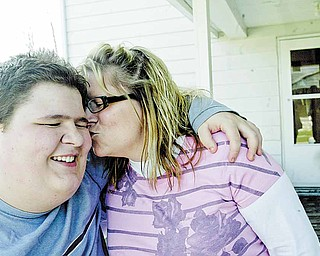 William D Lewis the vindicator Derrick Lind, 15, gets a kiss from his mother Chrissy Lind. They are from Struthers.
