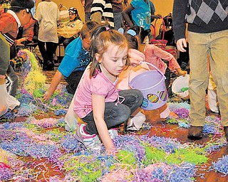 Chloe Reidmann of Niles participates in the easter egg hunt at Park Vista located on Fifth Avenue in Youngstown.  The event was part of the United Way Day of Caring.