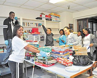 Youngstown Connection members cleaned and organized the activity room at the Burdman Group on Broadway Avenue. More than 100 area young people participated in Saturday's Youth Day of Caring in Youngstown.