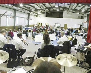 The Dixie Dandies, a local Dixieland Band performs at Wildare United Methodist Church in Bristolville on April 2. From left they are Bob Lewis, Bill Carson, Chris Eldridge, Joe Commarata, Nicole Angelli, John Yaksich and Connie Shultz. On drums is Grant Shultz.