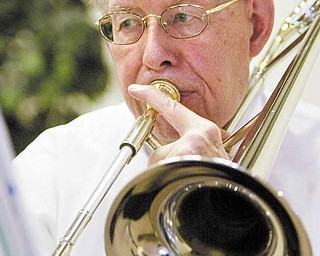 Bill Carson plays trombone with the Dixie Dandies.