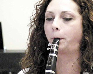 Lisa Angelilli plays clarinet with the Dixie Dandies.
