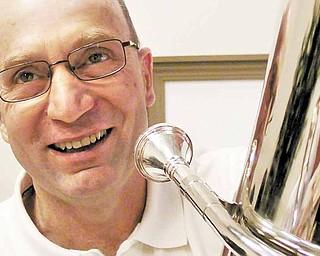 Bob Lewis plays Tuba with the Dixie Dandies.