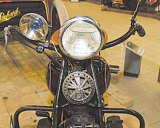 """A four cylinder 1934 Indian Model 434 is among 30 motorcycles on display through the end of May at the The 11th annual antique motorcycle exhibit, """"Motorcycles on Main Street,"""" at the National Packard Museum in Warren."""
