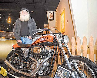 """Dennis Copley of Mogadore stands by his 1972 Harley Davidson XR 100 Special, which he loaned the National Packard Musem for its 11th annual antique motorcycle exhibit, """"Motorcycles on Main Street."""""""