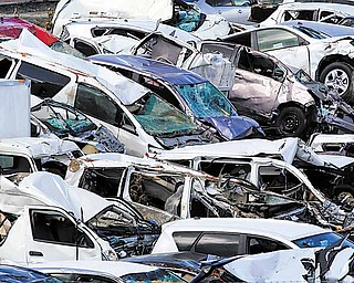 In this photo taken Monday, April 4, 2011, new vehicles damaged by the March 11 tsunami are placed in a Toyota Motor Corp. parking lot at Sendai port, Miyagi prefecture, northern Japan. The imperative to resume normal output is pressing for small parts suppliers throughout northeast Japan, which must keep customers happy or face the prospect of losing major business to competitors at home and abroad.