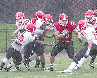 The Red team's Jamaine Cook (35) looks for an opening through the White team's defense during the Youngstown State University football team's annual spring game Saturday at YSU's Stambaugh Stadium. The White team won, 24-14.