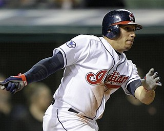 Cleveland Indians' Asdrubal Cabrera watches his bases-loaded single in the seventh inning, which drove in two runs against the Baltimore Orioles in a baseball game Friday, April 15, 2011, in Cleveland.